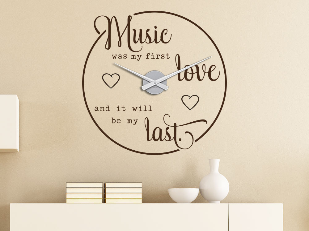 Music was my first love Wandtattoo Uhr als Wohnzimmerdeko auf heller Wand