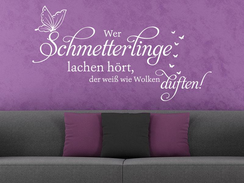 Wandtattoo Wer Schmetterlinge lachen hört... über Sofa