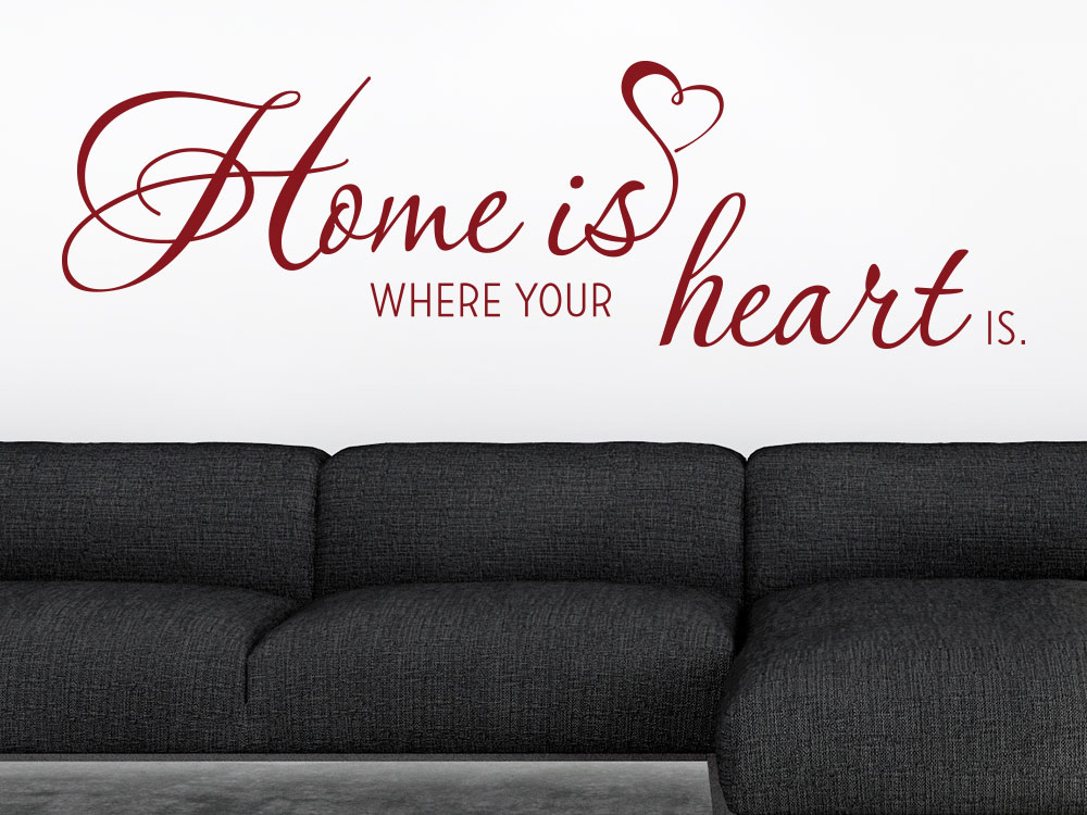 Wandtattoo Home is where your heart... in Rot über Sofa