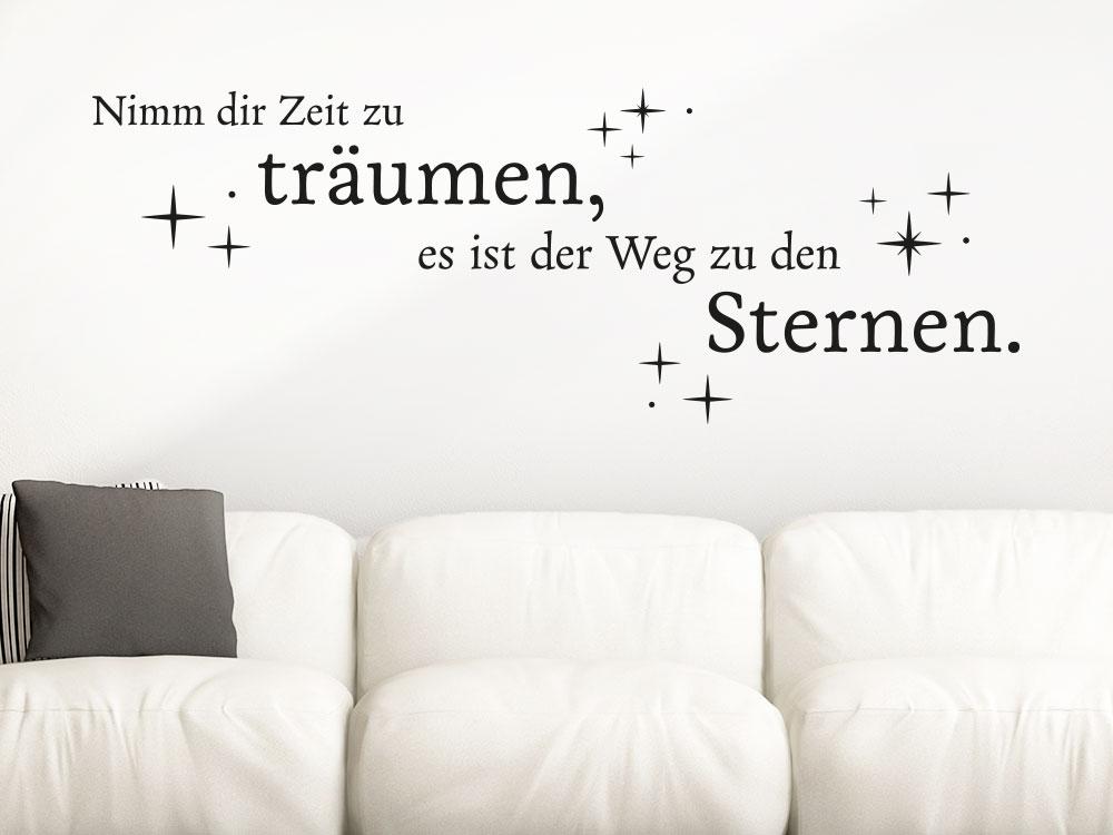 Wandtattoo Nimm dir Zeit zu träumen mit Sternen über hellem Sofa