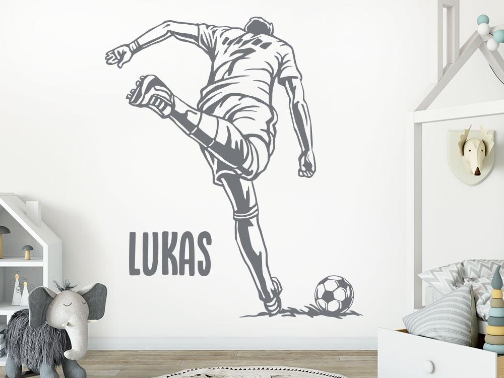 Wandtattoo Fußballstar mit Wunschname im Kinderzimmer