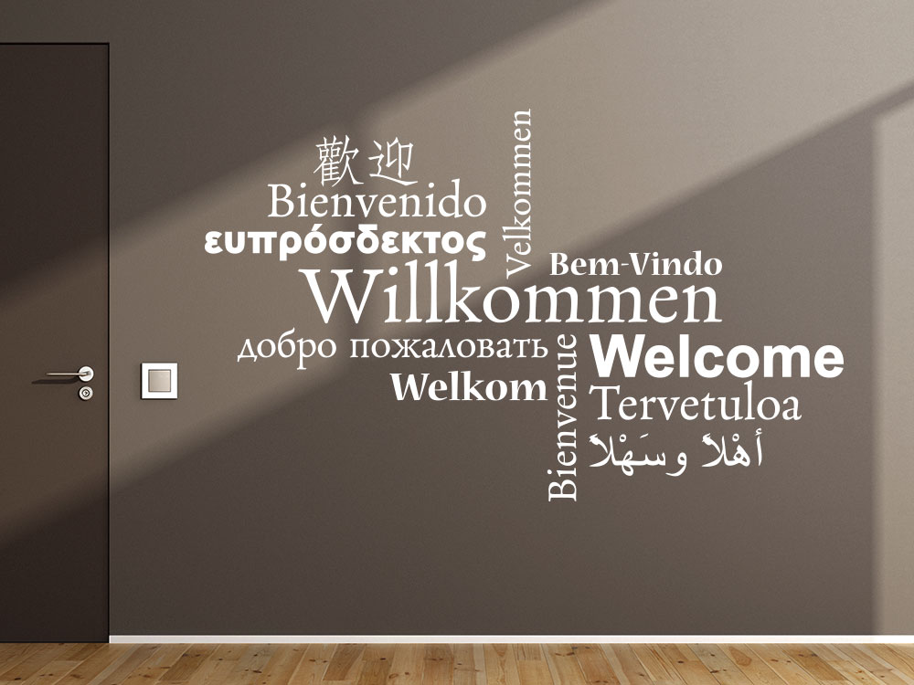 Wandtattoo Willkommen Wandbeschriftung neben Eingangstür