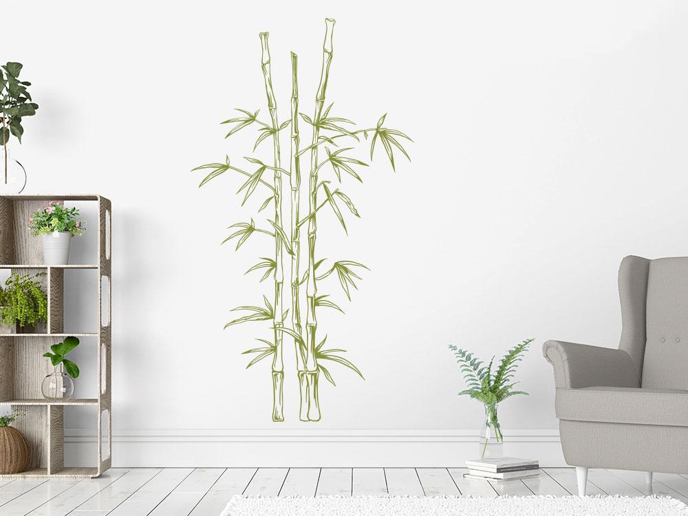Wandatttoo Bambus in Grün auf heller Wand im Wohnzimmer