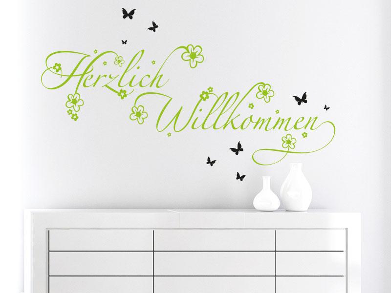 Wandtattoo Herzlich Willkommen mit Blüten und Schmetterlingen. - zweifarbig