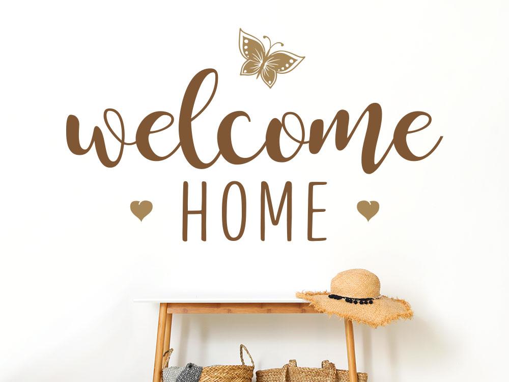 Wandtattoo welcome home zweifarbig mit Schmetterling und Herzen