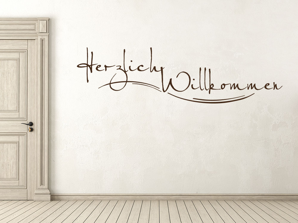 Schriftzug Wandtattoo Herzlich Willkommen neben Eingangstür