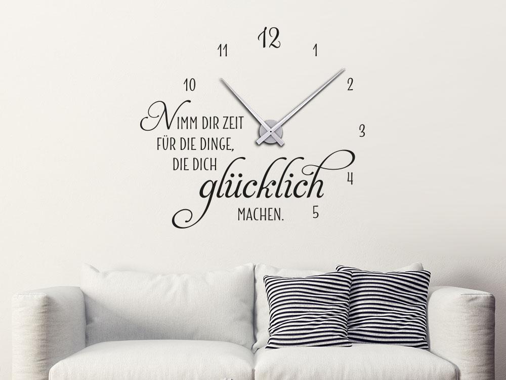 Wandtattoo Uhr glücklich machen im Wohnzimmer über Couch