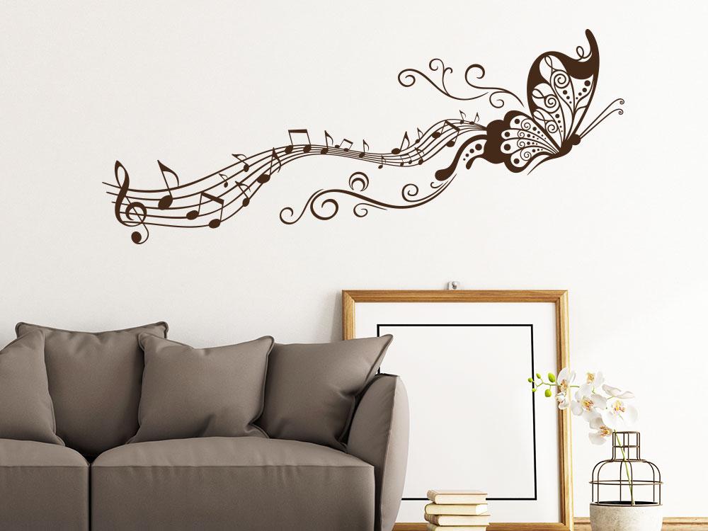 Wandtattoo Schmetterling mit Notenlinie in der Farbe Braun