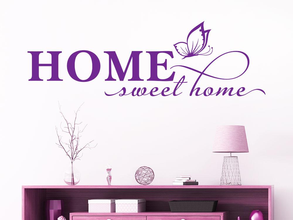 Wandtattoo Home sweet home mit Schmetterling auf heller Wand
