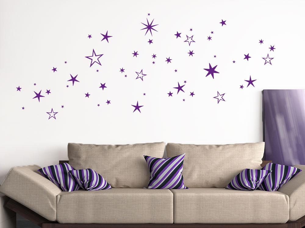 Wandtattoo Weihnachtlicher Sternenhimmel auf heller Wand in violett