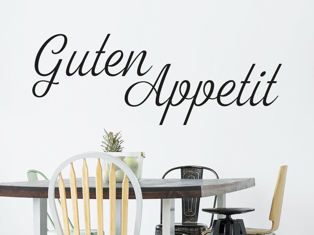 Wandtattoo Guten Appetit Schriftzug neben Esszimmertisch