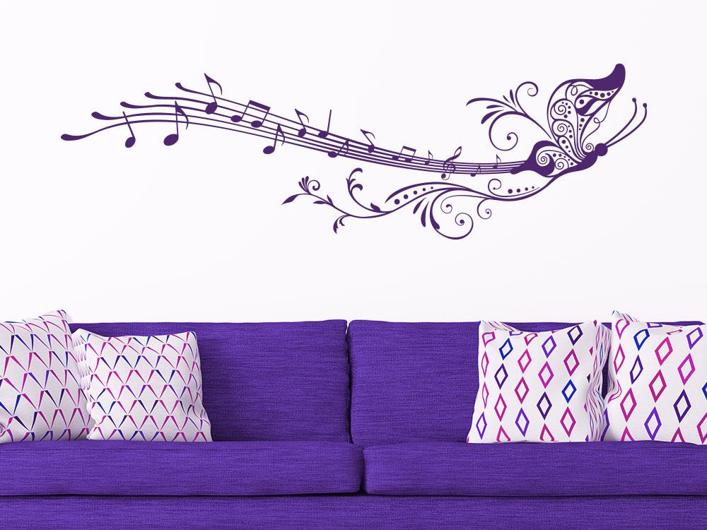 Wandtattoo Noten Schmetterling mit Notenlinie im Wohnzimmer