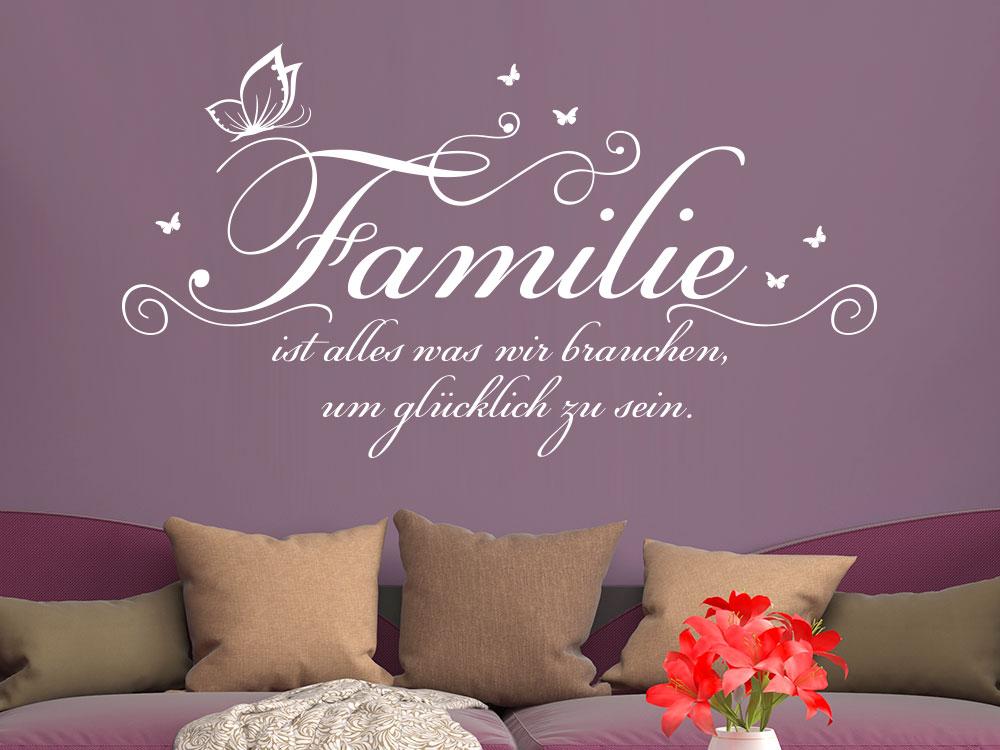 Wandtattoo Familie ist alles... über großer Couch im Wohnzimmer