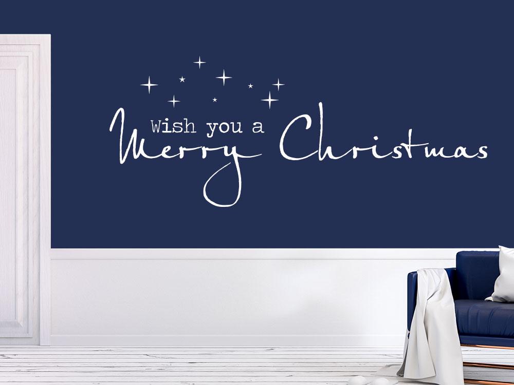 Englischer Wandtattoo Spruch Wish you a merry Christmas in weiß auf dunkler Wand.