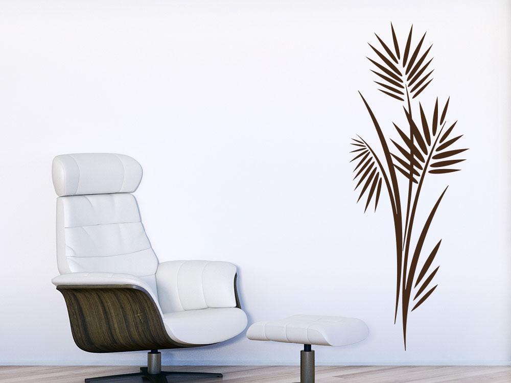 Wandtattoo Blätterstrauch neben Sessel im Wohnzimmer