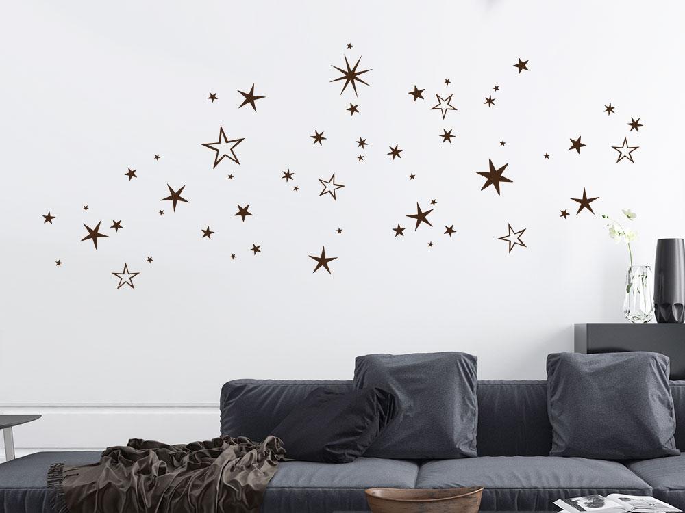 Wandtattoo Weihnachtlicher Sternenhimmel im Wohnzimmer über Couche
