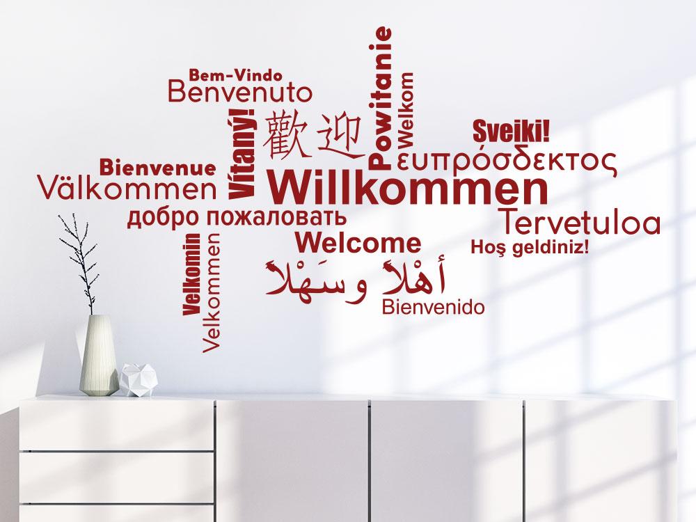 Wandtattoo Willkommen Wortwolke Multikulturell über Kommode im Flur