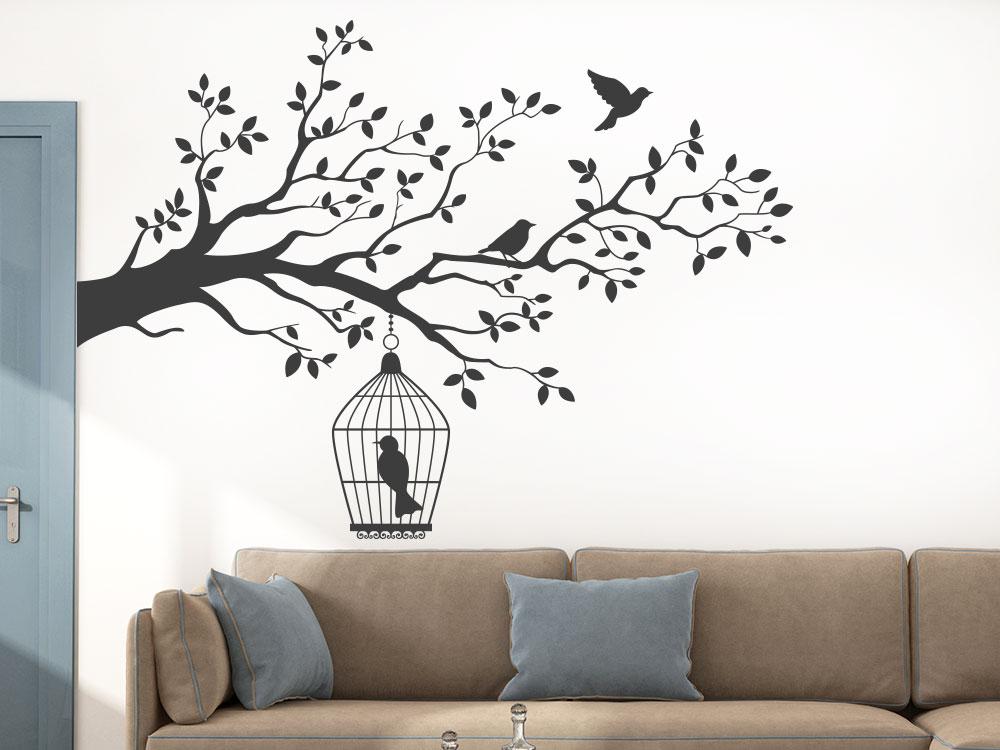 Wandtattoo Ast mit Vogelkäfig im Wohnzimmer