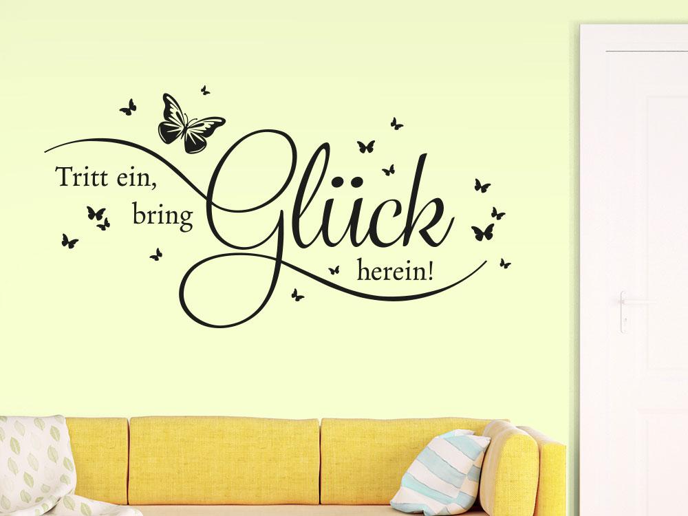 Wandtattoo Spruch Tritt ein, bring Glück neben Eingangstür