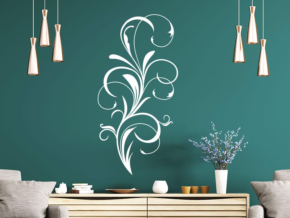 Wandtattoo Schnörkel-Ornament über einer Kommode in der Farbe Weiß