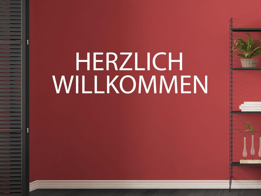 Wandtattoo Modernes Herzlich Willkommen auf roter Wandfarbe
