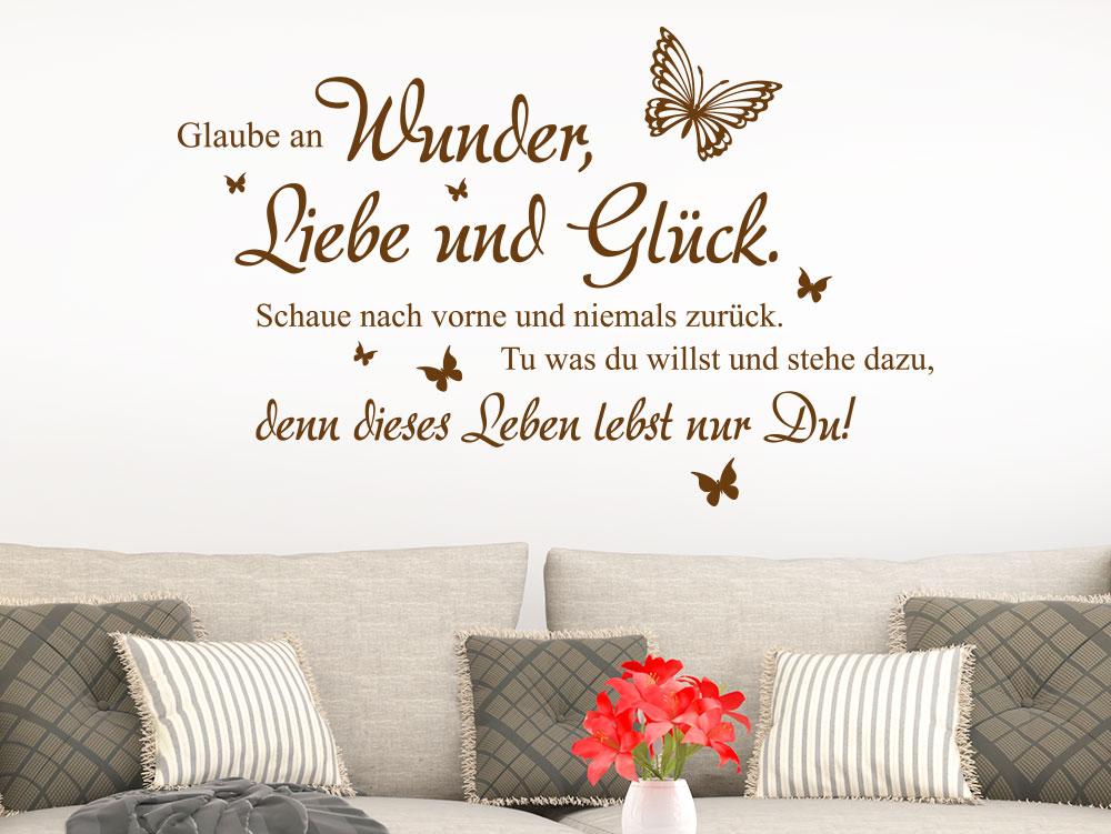 Wandtattoo Wunder Liebe und Glück über Sofa