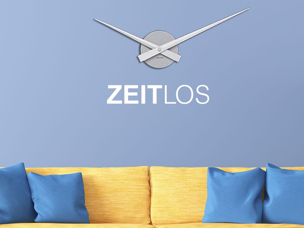 """Zeitlose Wanduhr mit dem Schriftzug """"Zeitlos"""" ohne Zahlen und Ziffern"""