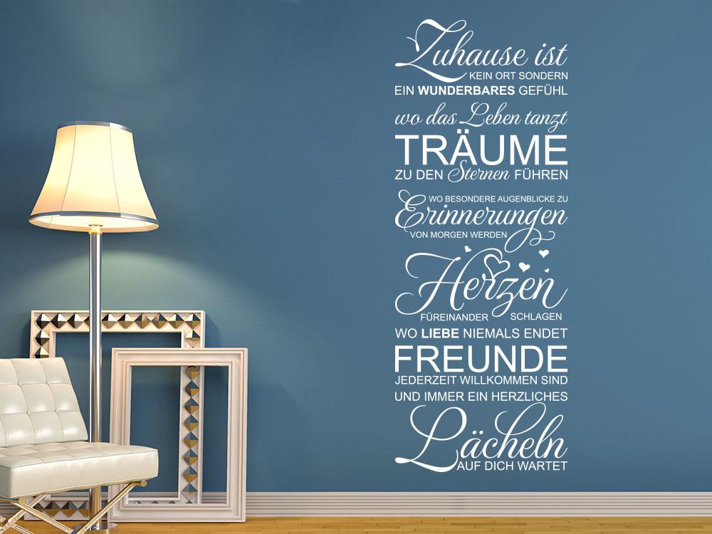 Wandtattoo Zuhause ist… Spruch in Weiß auf blauer Wandfläche