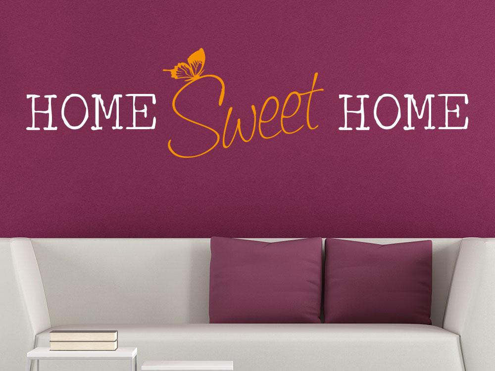 Wandtattoo Home Sweet Home zweifarbig auf roter Wand im Wohnbereich