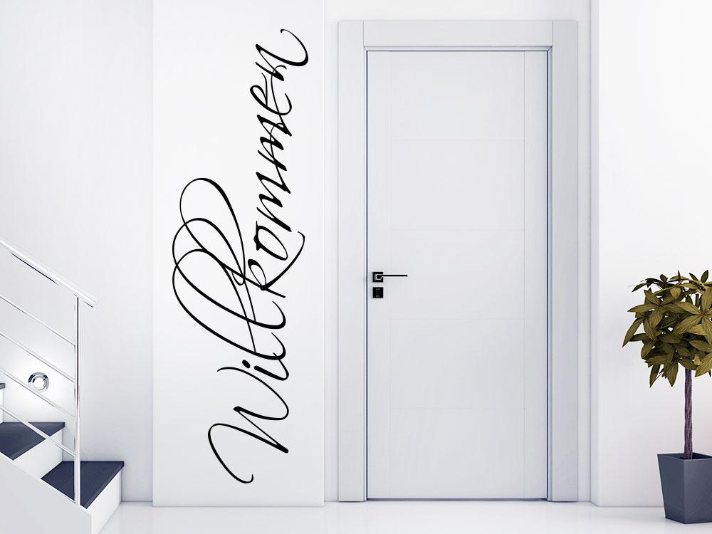 Wandtattoo Willkommen No.3 senkrecht neben einer Tür