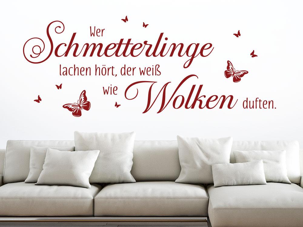 Wandtattoo Wer Schmetterlinge lachen hört über Sofa in Farbe rot